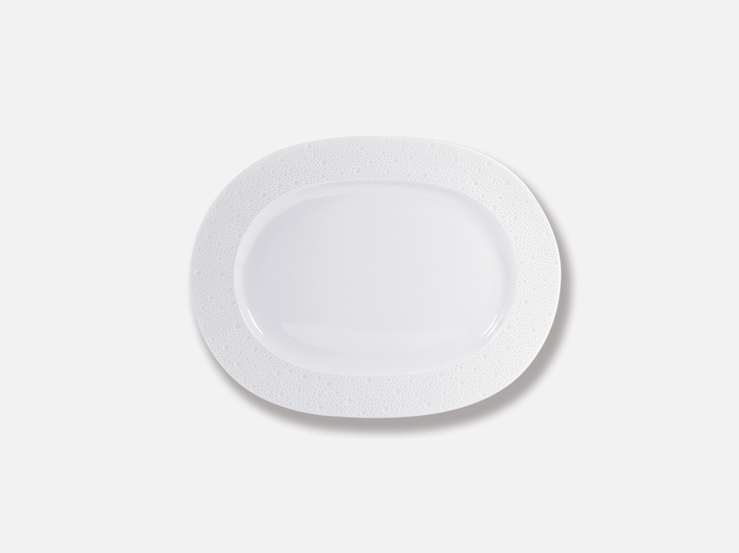 Assiette ovale 30 cm en porcelaine de la collection Ecume Bernardaud