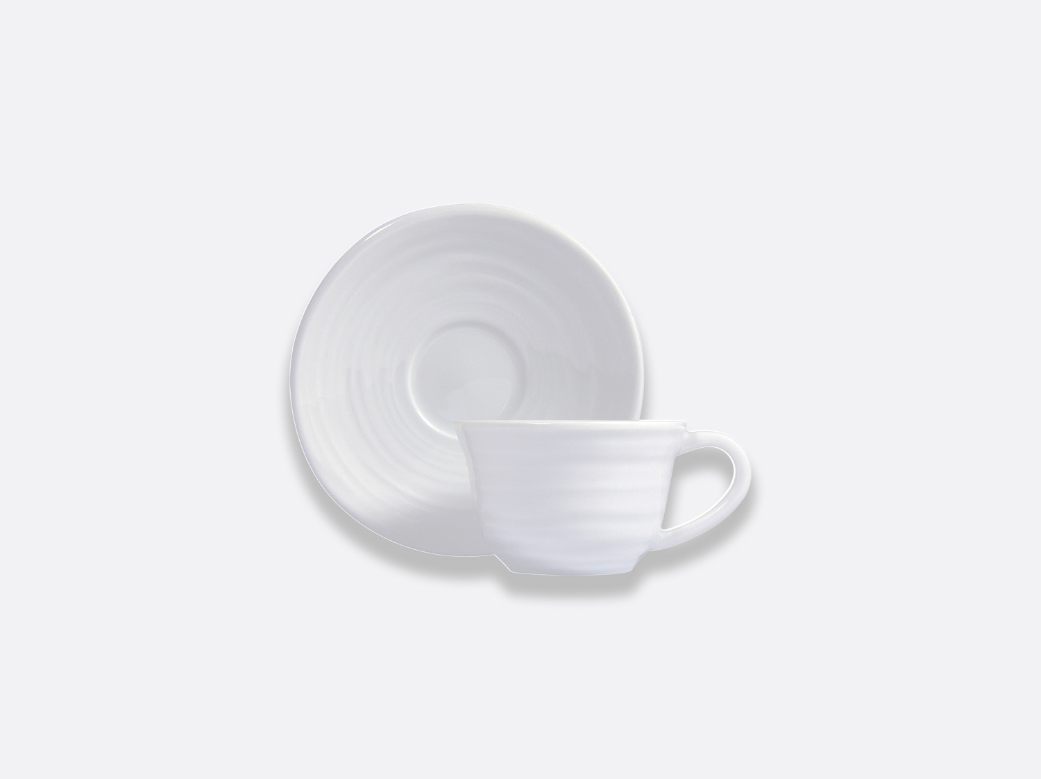 Tasse et soucoupe à café 8 cl en porcelaine de la collection Origine Bernardaud