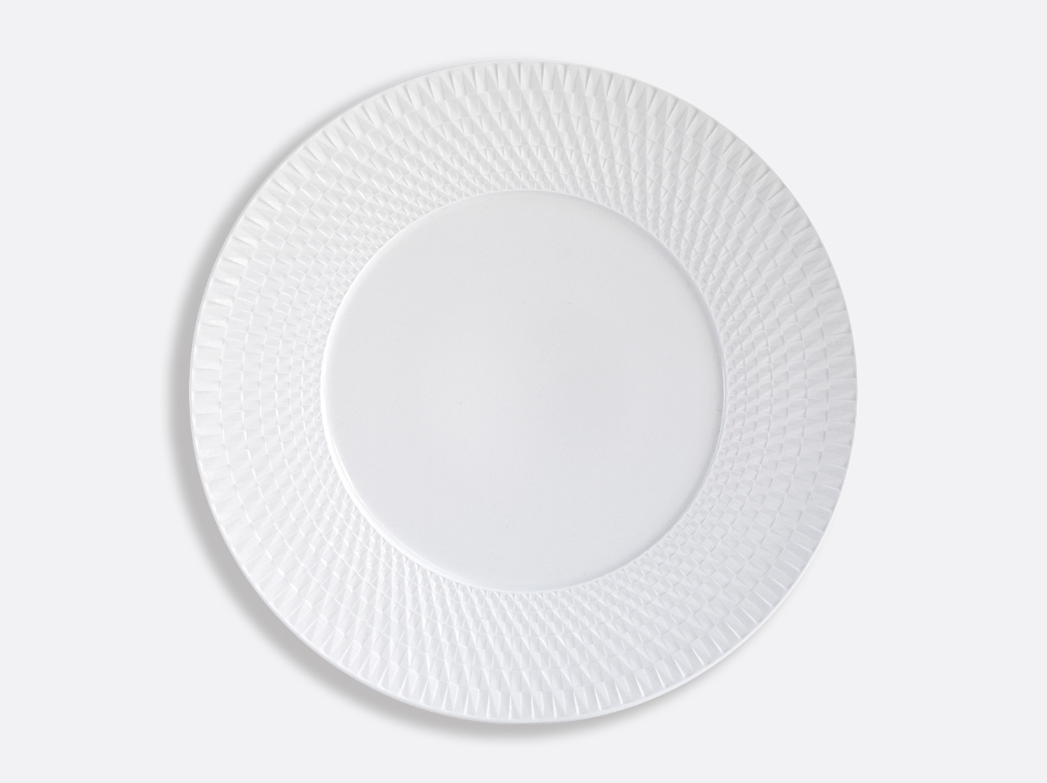 Assiette de présentation 29,5 cm en porcelaine de la collection Twist Bernardaud