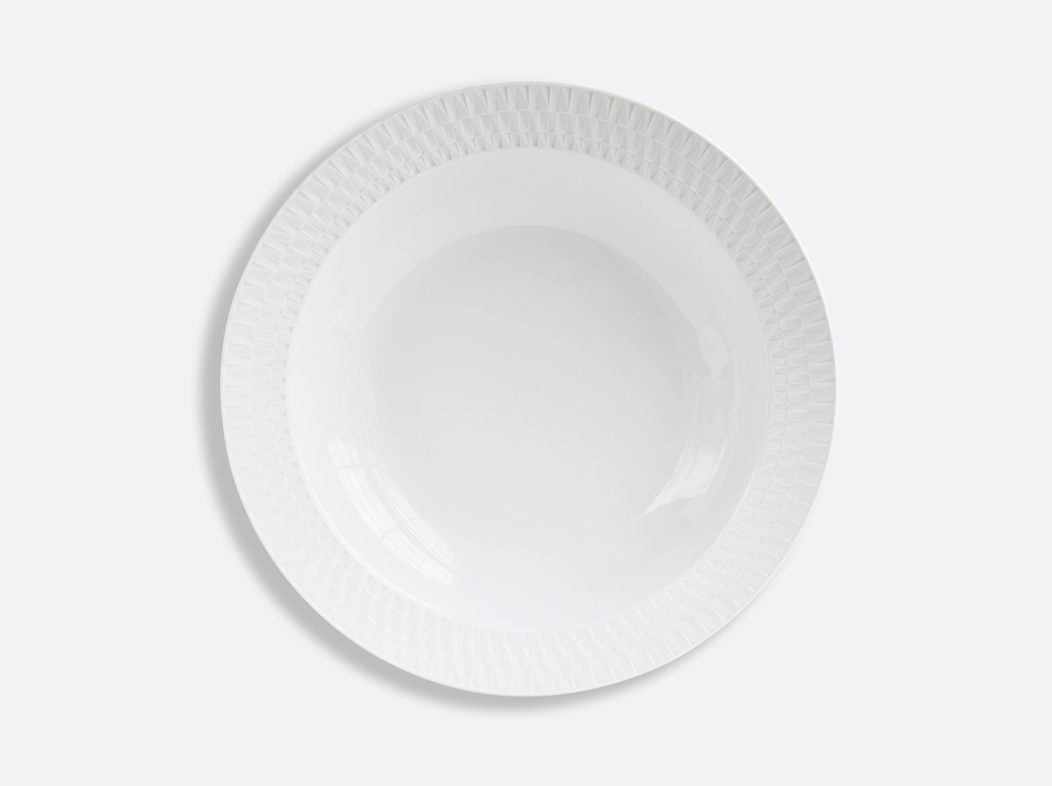 Plat rond creux 29 cm en porcelaine de la collection Twist Bernardaud