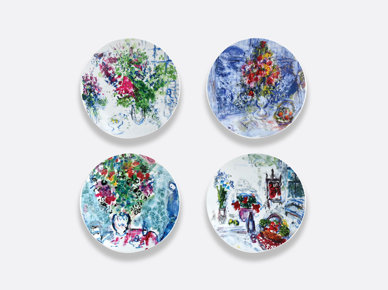 Coffret de 4 assiettes 21 cm assorties en porcelaine de la collection LES BOUQUETS DE FLEURS DE  MARC CHAGALL Bernardaud